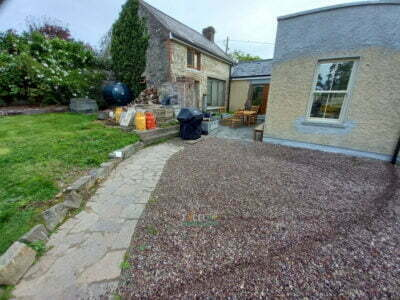 Black Granite Patio Area with Natural Paved Border in Carrignavar, Co. Cork