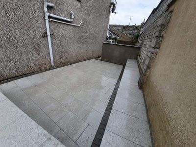 Granite Patio with Raised Seating Area in Douglas Cork